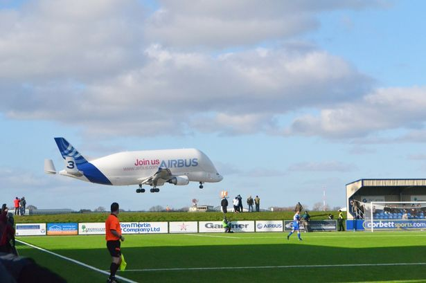 'It was an epic photobomb!': Stunning shot of Airbus Super Transporter over North Wales football ground lands schoolgirl top photography prize - Wales Online
