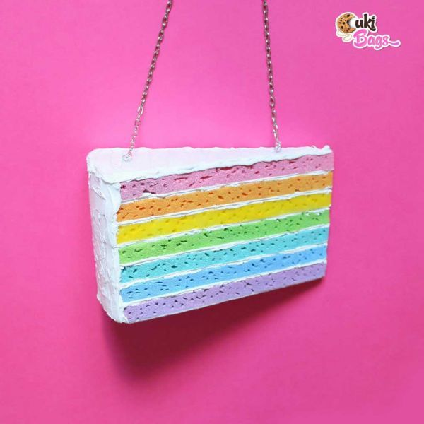 Itsy Bitsy Tiny Miny-Piece of cake rainbow purse/clutch bag, a great mix of multiple flavours glazed with white buttercream icing. A handmade clutch / bag which fits perfectly with a flower power girl. Available also as a full rainbow cake purse/clutch bag. WORLDWIDE DELIVERY - FREE SHIPPING for orders over $200;