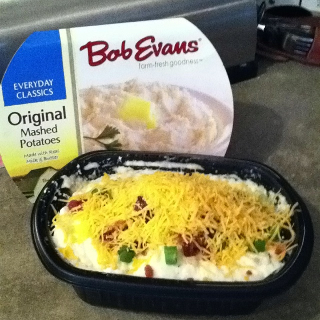 My souped up bob evans mashed potatoes! Mocrowave premade bob evans mashed potatoes for 3min. Then add diced scallions, real bacon bits(i use hormel) and shredded cheese. Microwave for another 2 min. Bam! Done! Best. Potatoes. Ever!!
