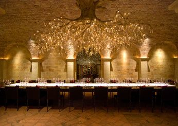 The subterranean tasting room at HALL Rutherford, built with limestone and reclaimed 19th century Austrian bricks, is situated directly below its Sacrashe Vineyard. More than 35 pieces of contemporary art are on display here, but the focal point is the eye-catching chandelier, representing a grapevine root system and accented with 1,500 Swarovski crystals.