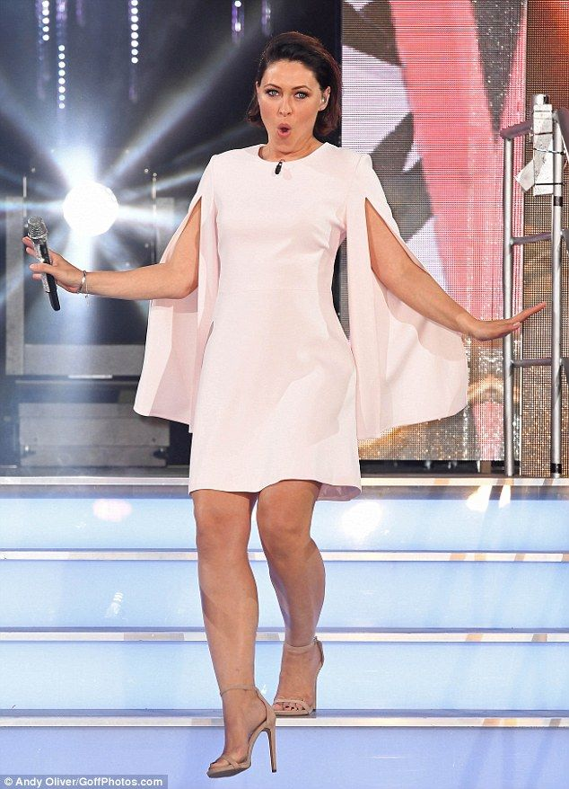 A vision in white: TV presenter Emma Willis looks fabulous in a caped white dress as she h...