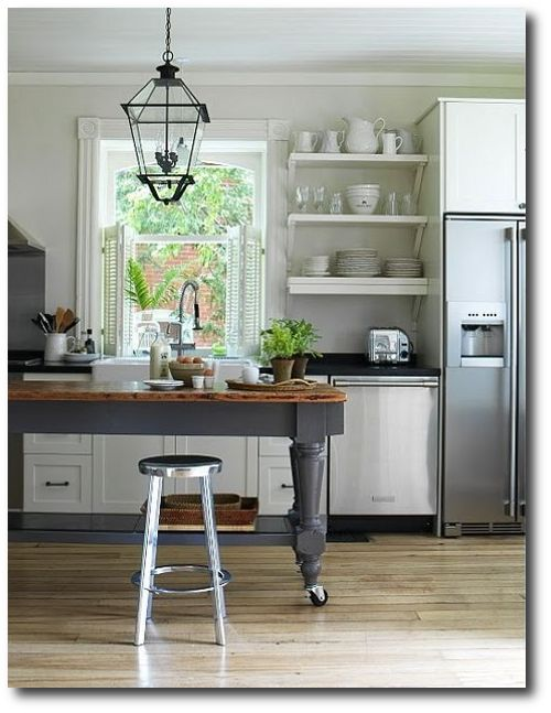 I love the rustic utilitarian feel of the farmhouse kitchen island And tha