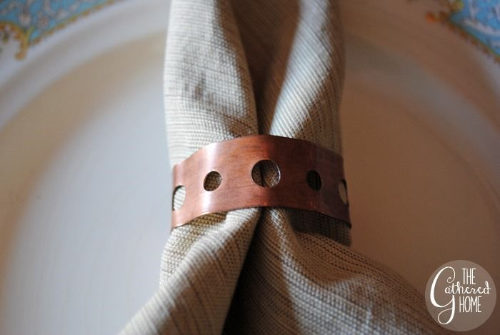 Copper straps found in the plumbing aisle make cool industrial napkin rings!