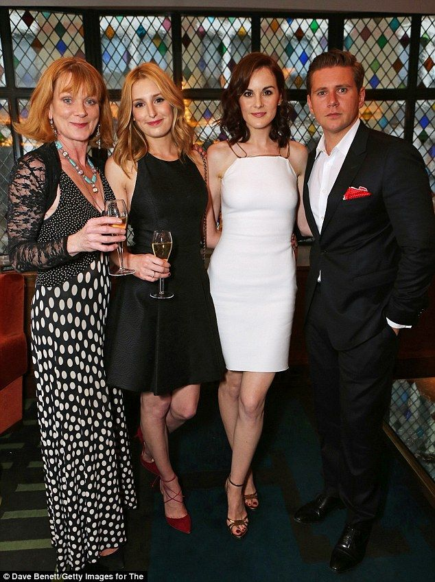 Cheers! The actors - joined by Samantha Bond - raise a gl;ass to their success on the ITV ...