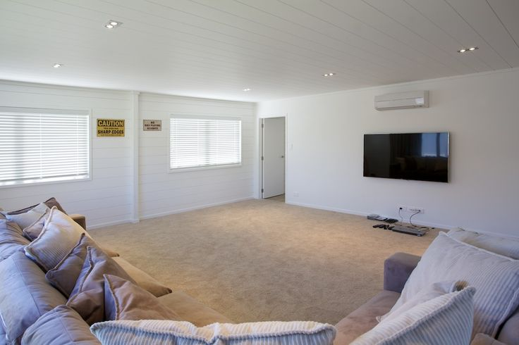 Double garage area being used as a rumpus and media room for weekend and holiday guests. Lockwood beach house