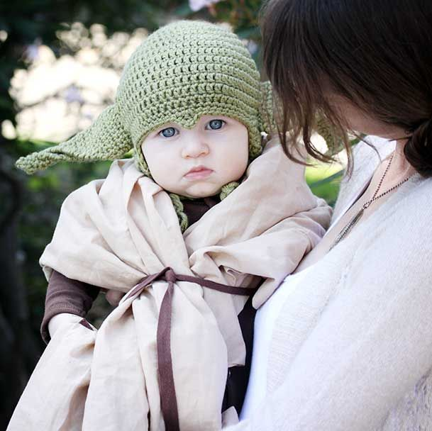 Our New Baby Yoda; Oliver's 2012 Halloween costume. (and even mommy has Princess Leia Buns). The yoda costume cost less than $35, including purchasing the hat on etsy. (but we had the brown onesie already)