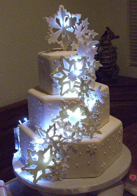 "Winter Wonderland Cake! Looks incredible with LED lights behind the snowflakes. Here, use these if you want to re-create the look - LED ""ice cubes"" made of FDA approved plastic: http://www.flashingblinkylights.com/light-up-products/lighted-ice-cubes.html"