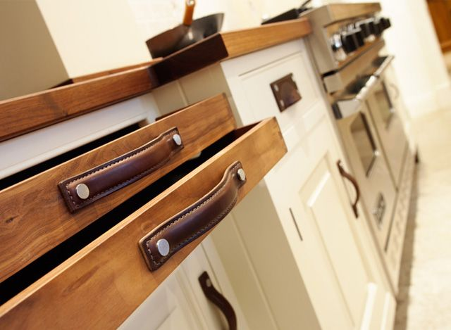 Kitchen Cabinets and Drawers with Strap Leather Cabinet Pull Handles and Brass Framed Cup Handles in Chestnut