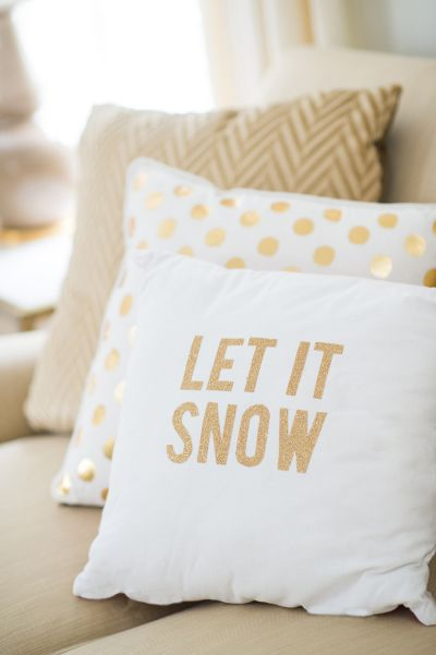 White and gold let it snow pillow: http://www.stylemepretty.com/2015/11/16/holiday-decor-ideas-that-wont-make-you-cringe/ Photography: Jenny Moloney - http://jennymoloney.com/