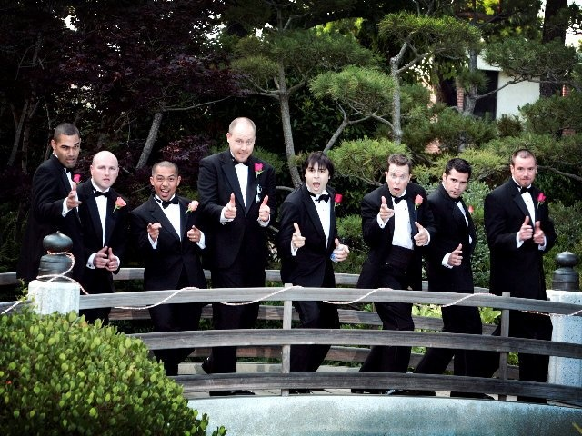Groomsmen in tuxedos with Bow tie