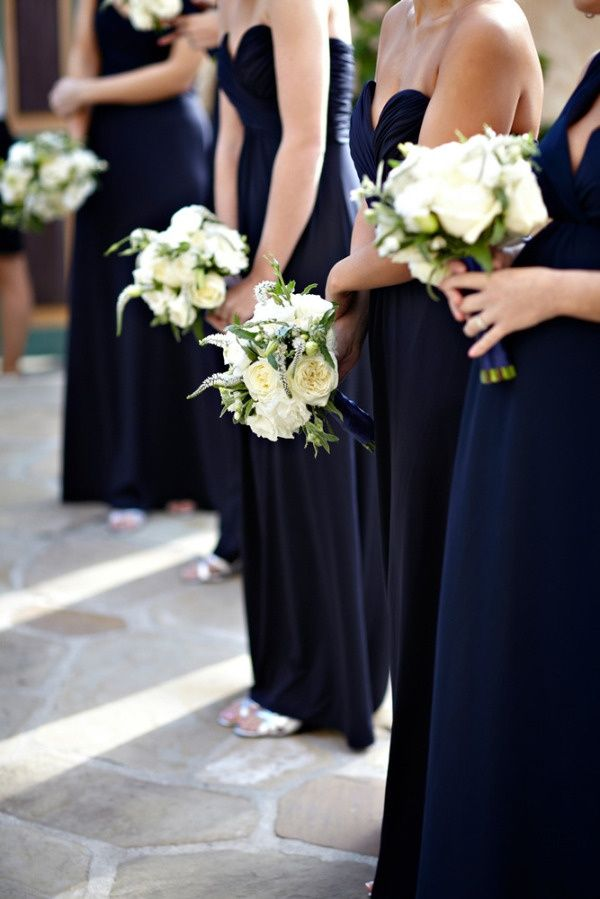 navy blue bridesmaid dresses with white bouquets