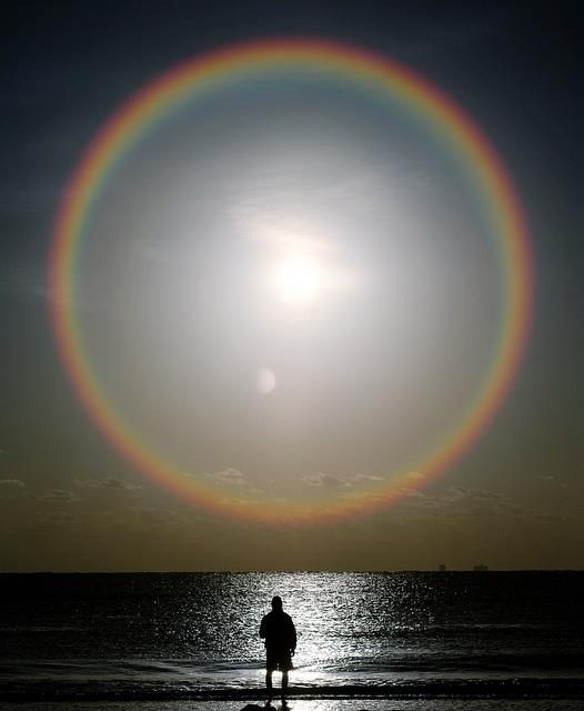 Night Rainbow or as i believe they're called a Halo and often indicate moisture in the air so some type of precipitation is coming soon