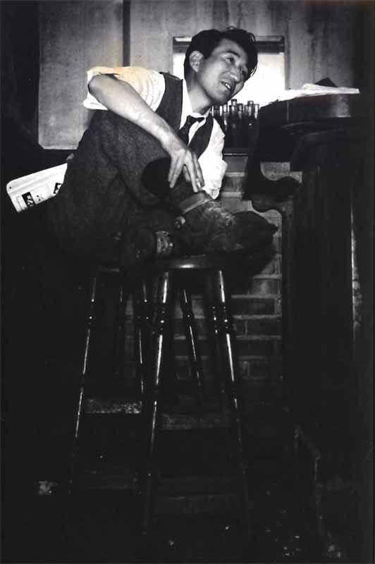 Japanese author Osamu Dazai (太宰治) at Bar Lupin, Ginza.  Photo by Tadahiko Hayashi (林 忠彦).