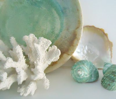 Here is an idea if you want to do seafoam + white color scheme. If there is a shelf somewhere you could use these as decoration.