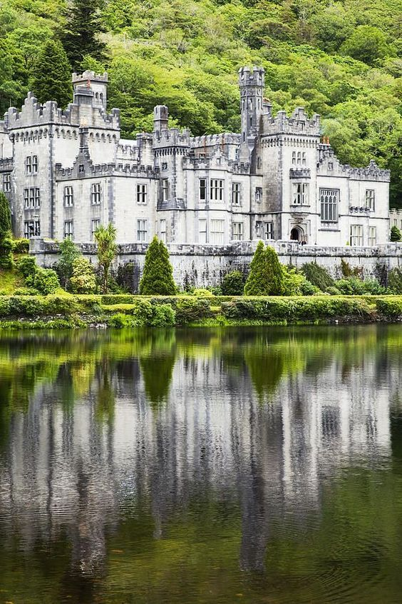 Kylemore Abbey, Ireland. Originally built as a private estate, this 40,000 square foot idyllic castle befell tragedy before it was donated to an order of nuns and became an Abbey.
