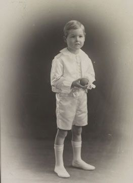 silk satin and crepe-de-chine page boy suit worn by Ernest Tinne, aged five, for his uncle's wedding in 1919.