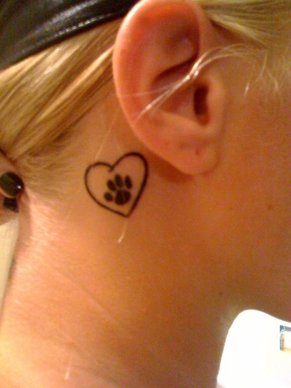 Paw print heart tattoo -- maybe not in that spot though