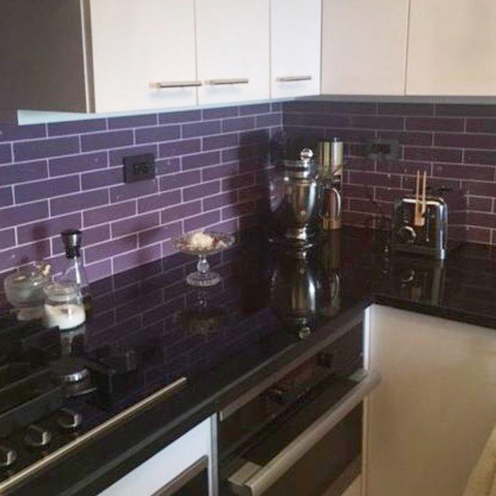 Black Galaxy Granite Kitchen Countertop With Purple Glass Backsplash Tile Countertops Granite Ba Kitchen Countertops Purple Kitchen Cabinets Purple Kitchen