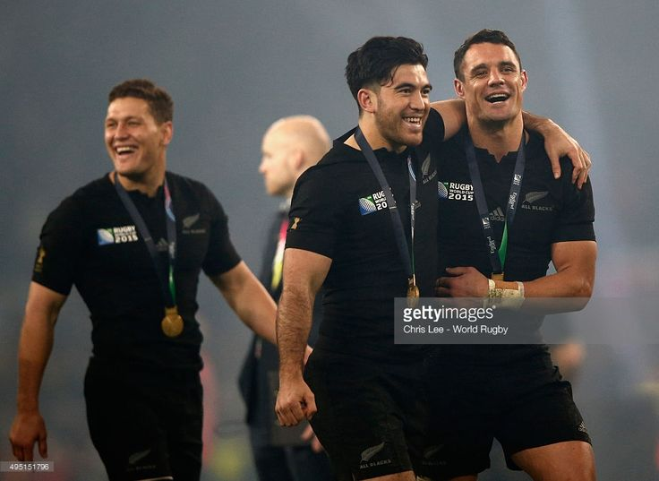 Nehe Milner-Skudder (L) and Dan Carter of the New Zealand All Blacks celebrate victory with their medals after the 2015 Rugby World Cup Final match between New Zealand and Australia at Twickenham Stadium on October 31, 2015 in London, United Kingdom.