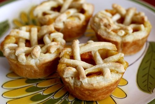 Mini peach pies are super easy to make when you use puff pastry as your pie crusts! Simply buy a box of puff pastry (usually located in the freezer section of grocery stores), a can of peach pie filling and sprinkle in a little cinnamon to add some extra flavor.