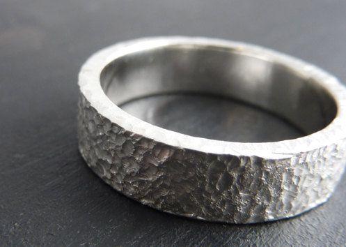 man fidgets with wedding ring