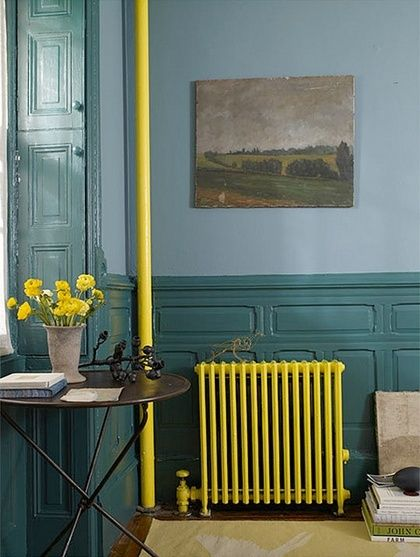 I love this bright yellow cast iron radiator