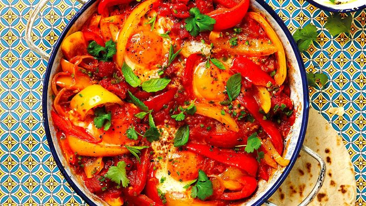 Turkish menemen Serves 4 Ingredients2 tbsp olive oil1 onion, finely sliced1 tsp fennel seeds½ tsp cumin seeds1 large green chilli pepper, deseeded and chopped2 red and 2 yellow (or green) peppers...