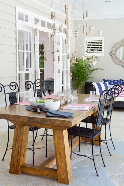 decks/patios - Covered white beadboard ceiling salvaged wood dining table wrought iron chairs candle chandelier French doors transom windows