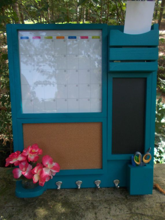 A message center thats 24 wide x 28 high  Top left a magnetic dry erase calendar, top right a mail holder  Below the dry erase calendar, a