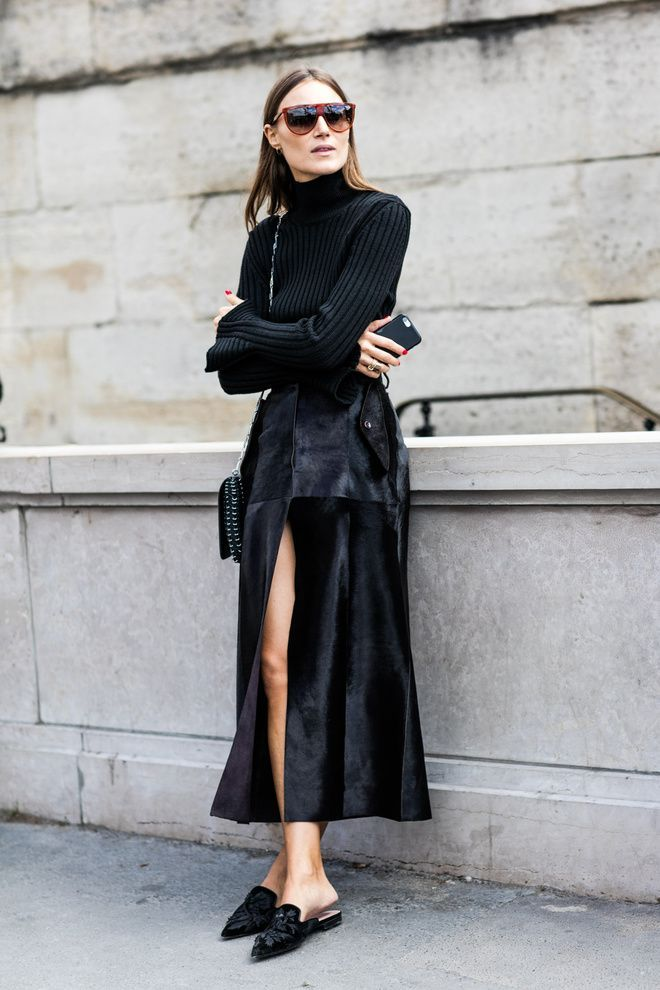 Everything about this outfit is to die for. Black knit turtleneck with midi suede skirt and topped off with velvet flat mules.