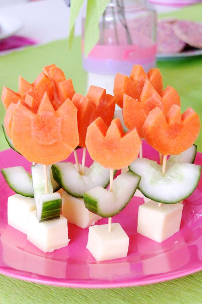 Use carrots and cucumbers to make these veggie flowers.
