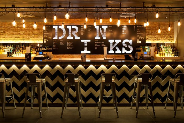 Roxy Bar in London; Love the tile pattern in classic black and white, it seems modern when set against the brick.