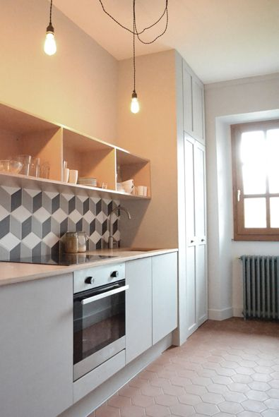 """kitchen at the snohome - tiles """"hex"""" from surface, ikea units, bespoke plywood top and cabinet, original french tomettes for floor, historic lighting bulbs"""