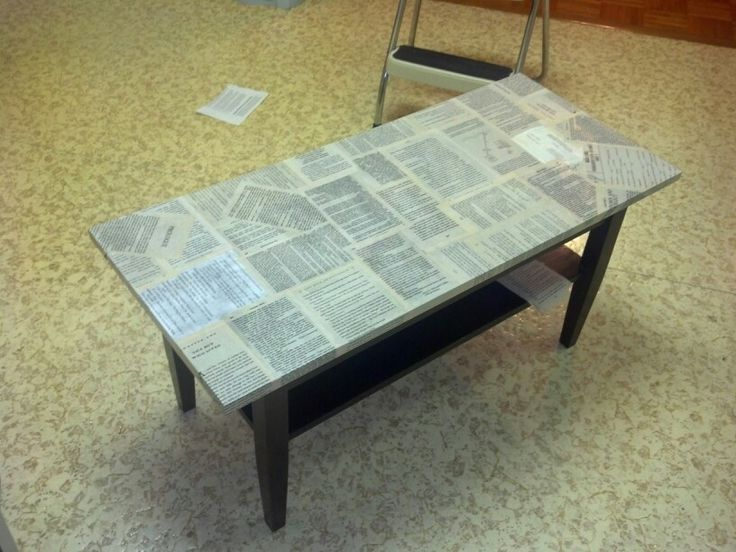 Modge podge book page table Found this old coffee table in the