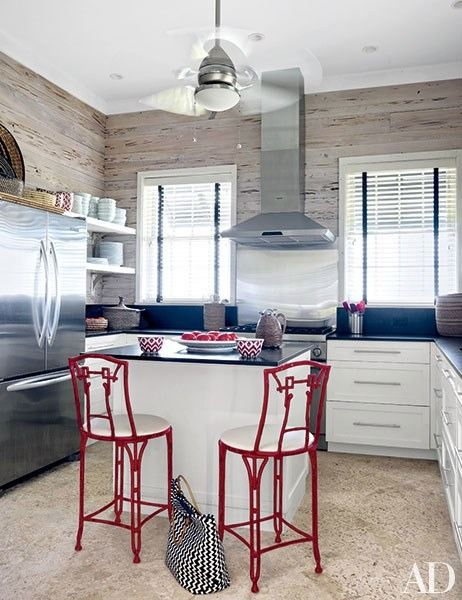 The kitchen of Alessandra Branca's Bahamas retreat is equipped with a Hunter ceiling fan and a Viking range and hood   archdigest.com