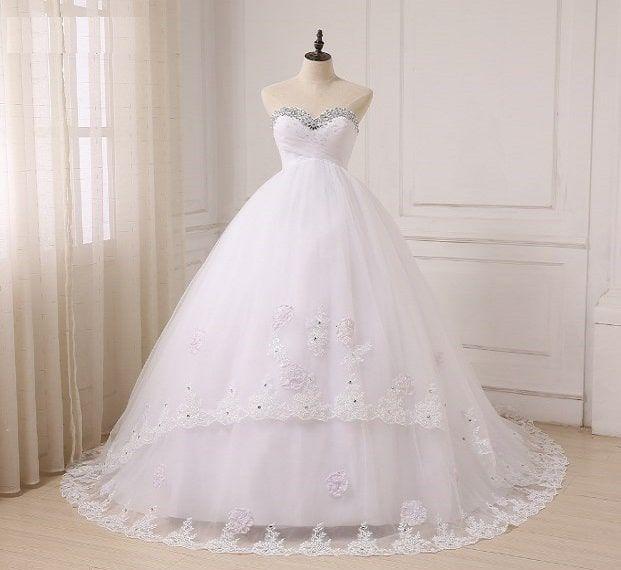 تفسير حلم الفستان الأبيض للحامل والعزباء لابن سيرين موقع مصري Ball Gowns Wedding Wedding Dresses Ball Gown Wedding Dress