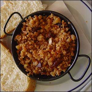 Migas de pan a la andaluza, any whole bread will make it with raisins, cinnamon, maple syrup or honey, nut meg and nuts. http://pinterest.com/megapicasso/