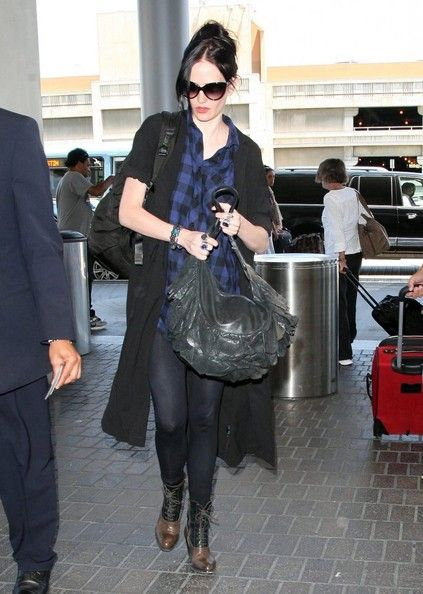'Sin City: A Dame To Kill For' actress Eva Green departing on a flight at LAX airport in Los Angeles, California on August 6, 2014. The latest trailer for the 'Sin City' sequel was deemed 'too sexy' by ABC and won't be aired because actress Eva Green appears to be naked in the ad.