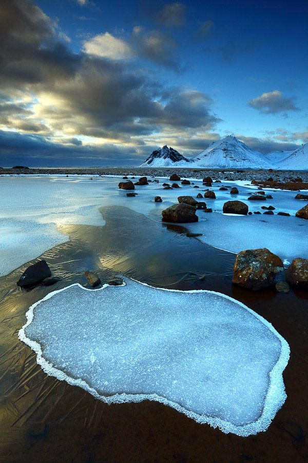Sunrise light towards the distinctive mountain profile of the Vesturhorn, near Hofn, Iceland...