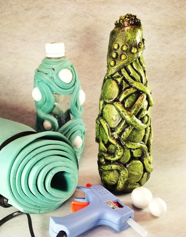 Water bottle decorated with foam and paint.