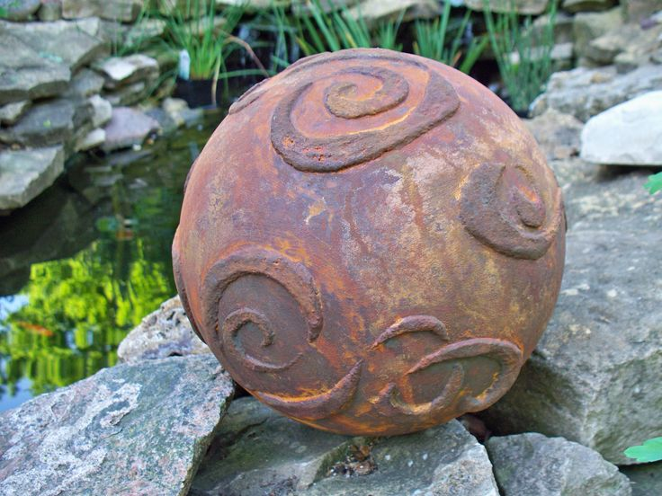 A transformed bowling ball using Modern Masters Metal Effects Iron Paint & Rust Activator by Allyce Lees of Waupaca, WI