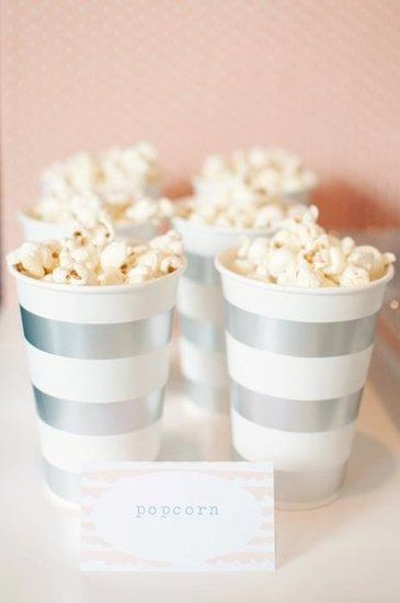 Popcorn: Silver and white cups served as popcorn holders.  Source: All the Frills