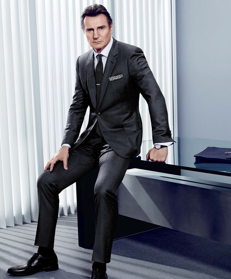 Charcoal Suit. Black Pindot Tie with a black gingham pocket square. Liam Neeson, GQ