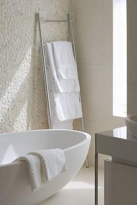 bathroom. pebble wall, egg bath.