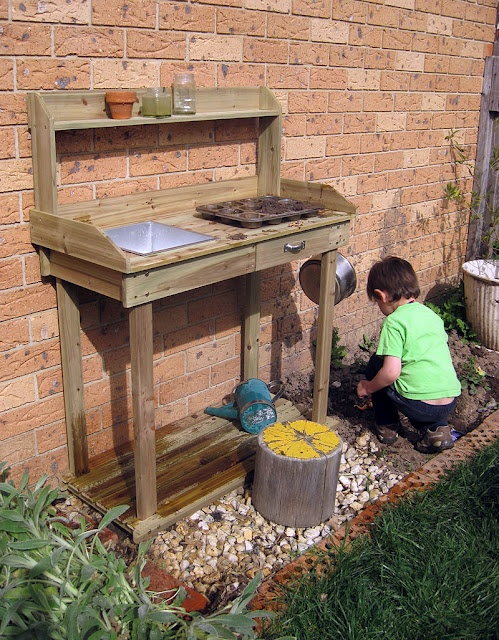 "Building a ""science station"" instead of a mud kitchen, because 10 year old boys want an excuse to play in the mud too!"