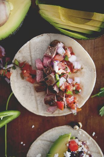 Growing up in Southern California, tacos were a constant fixture in my house. And not the ground beef, hard shell kind either. I'm talking norteno style carne asada, bright and spicy pico de gallo, and mountains of avocados from the tree in our back yard. My dog, Spike, would wander around with a green snout …