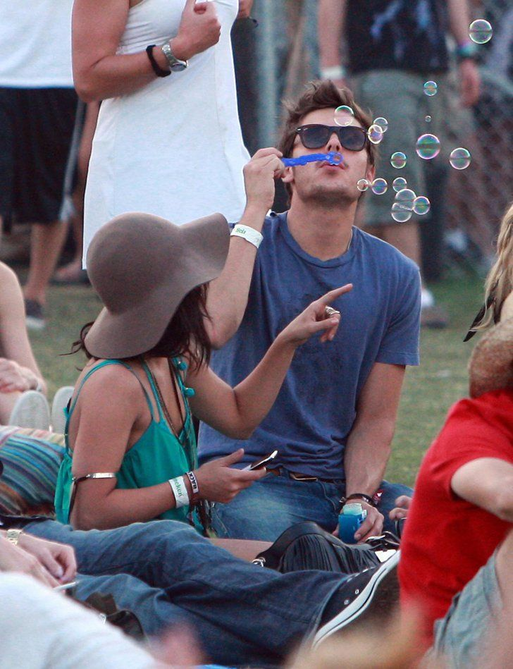 Pin for Later: Coachella Is Basically a Celebrity Paradise  Zac Efron blew bubbles while Vanessa Hudgens watched on in 2010.