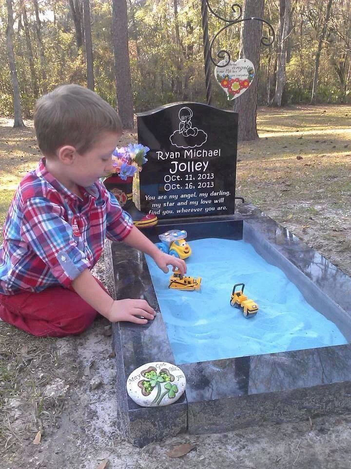 """Ryan's parents built a small sandbox over their son's grave so his brother could """"play"""" with him when they visited. ...the link is wrong..."""
