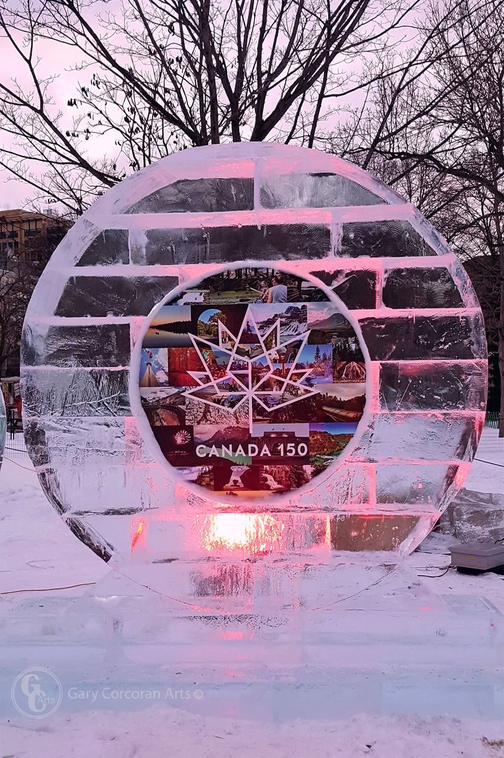 """Within an Arctic circle"" - This is a mobile phone photo I took of the, newly today unveiled, Canada's 150th ice sculpture in Confederation Park, Ottawa, ON, CAN.   Today is the first day of Winterlude 2017 falling on Canada's 150th birthday year. Will be a fun year!"