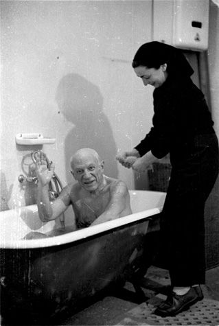 pablo picasso greets david douglas duncan for the first time from the bathtub where jacqueline is scrubbing his back, 1956.